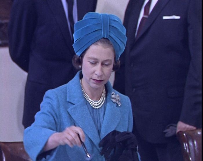 The Queen's Hats - British Pathé - The Queen work this Royal blue turban-style hat during a visit to Canada #queenshats
