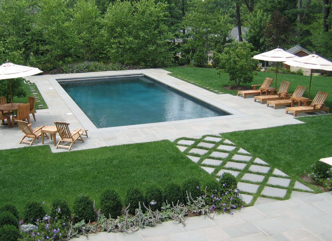 Rectangular swimming pool as part of formal nj backyard for Pool design hamilton nj