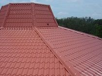 Building With Tile Effect Terrecotta Roofing Sheets And Ridge Capping Roofing Sheets Roofing Business Roof
