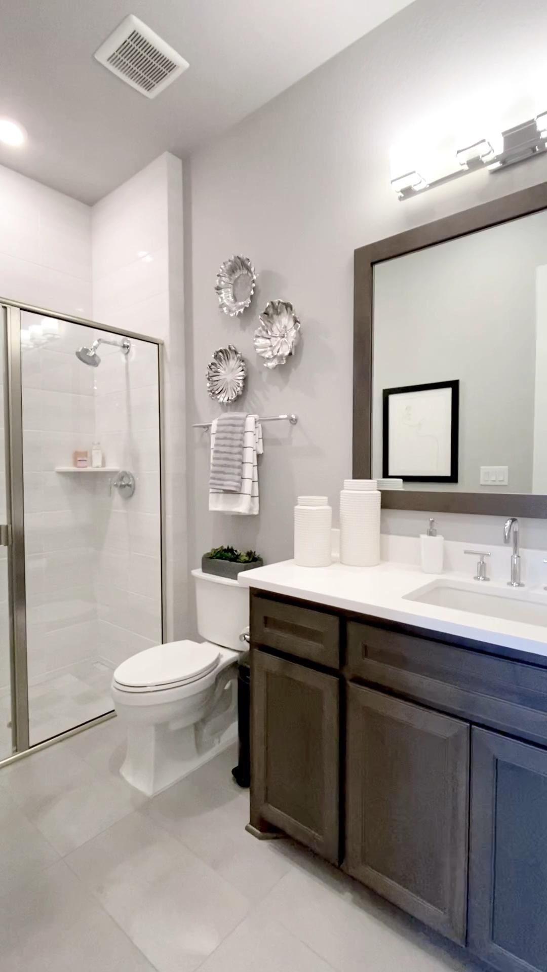 Bathroom design with dark stained cabinetry