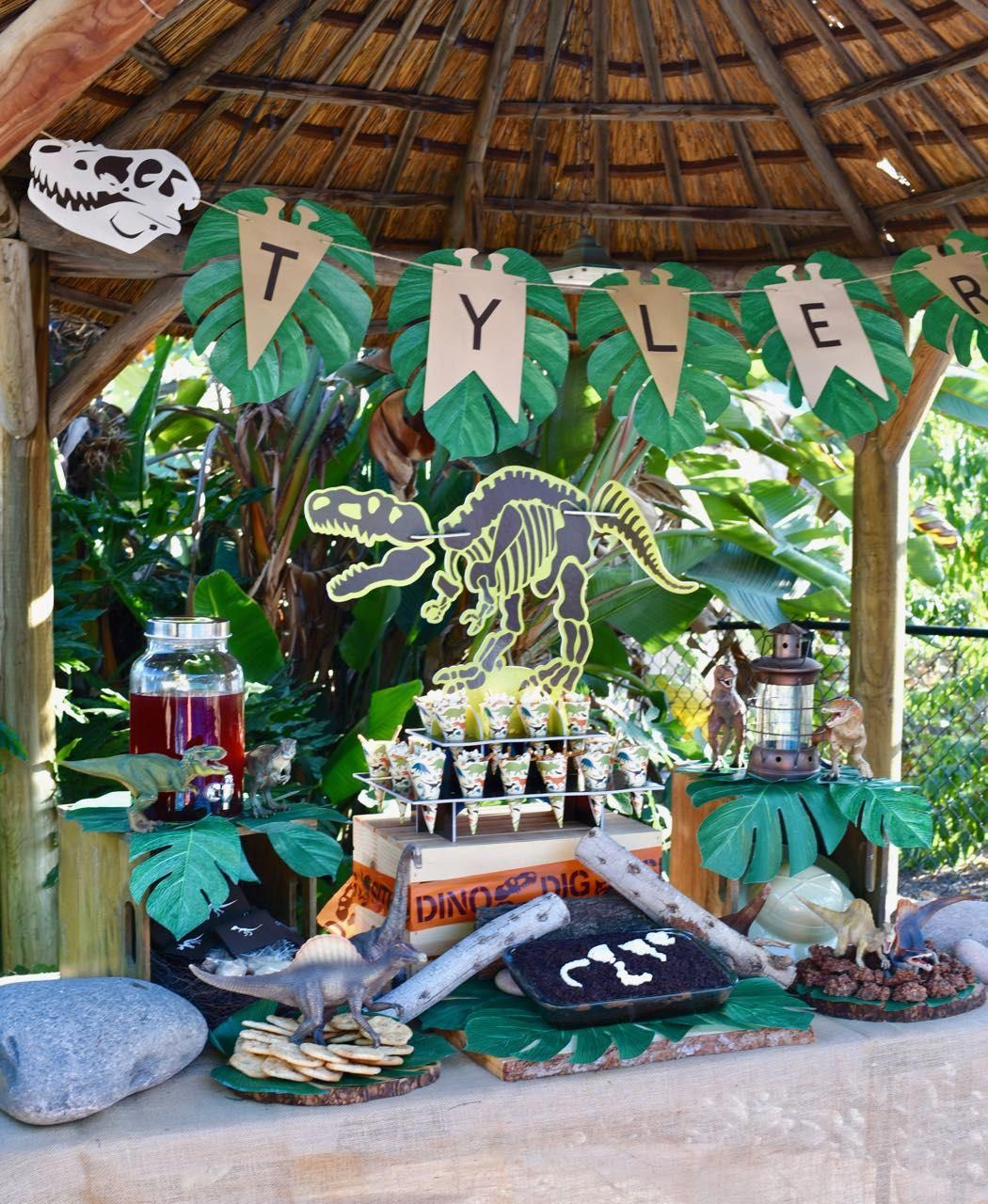 Photo of Dinosaur party with dinosaur cookies, dinosaur cake, lots of dinosaur decoration…