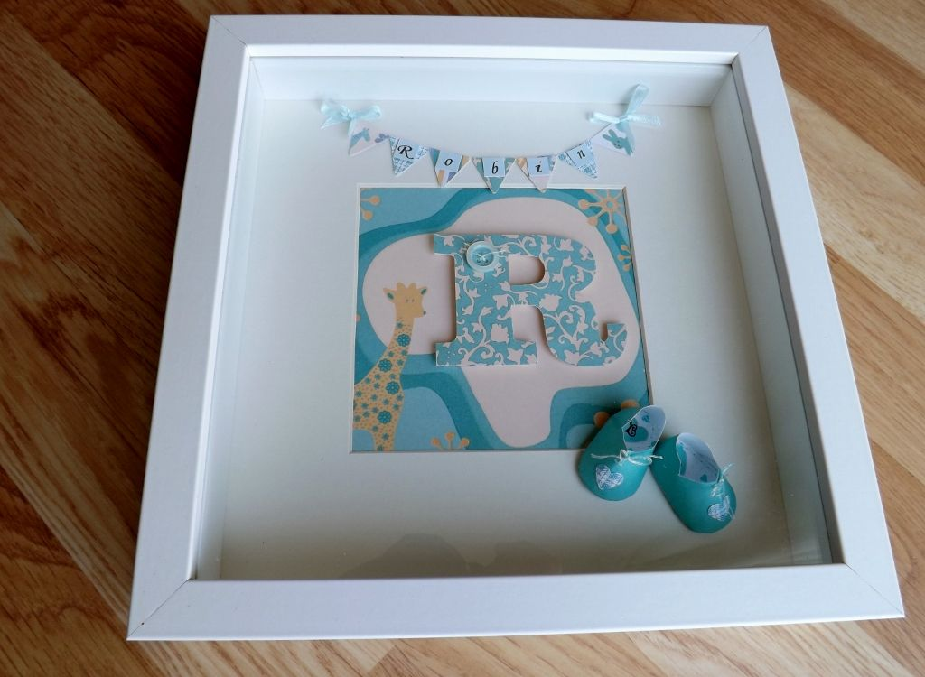 Name picture for baby's 1st birthday. Handmade/sewn tiny paper shoes :) by Bev Hobbs