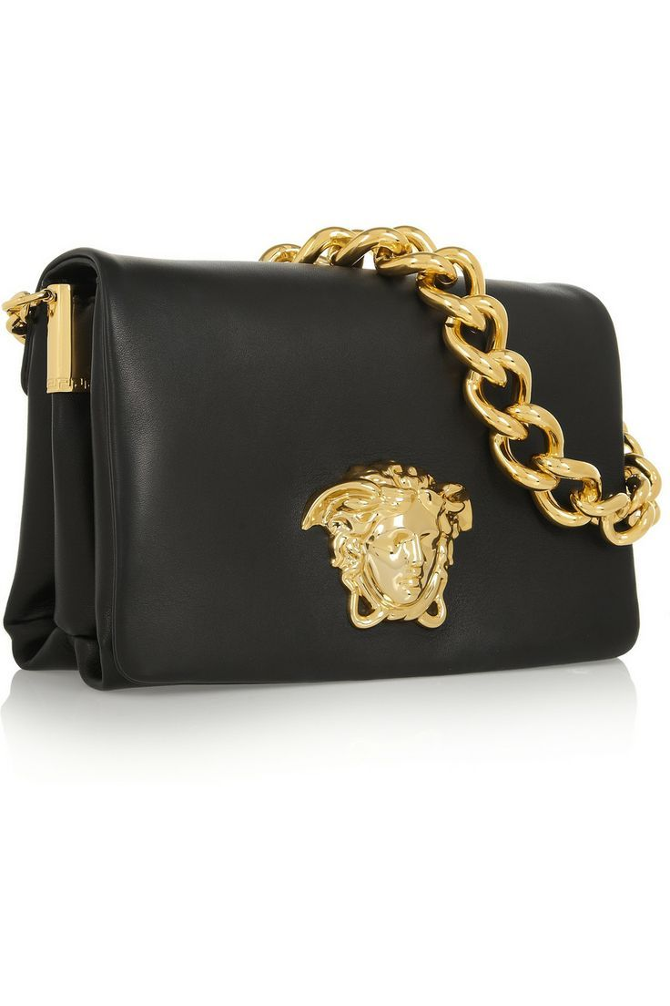 Black leather (Calf) Gold chain shoulder strap Gold designer plaque and  hardware Two internal compartments, pouch pockets Fully lined Magnetic ...