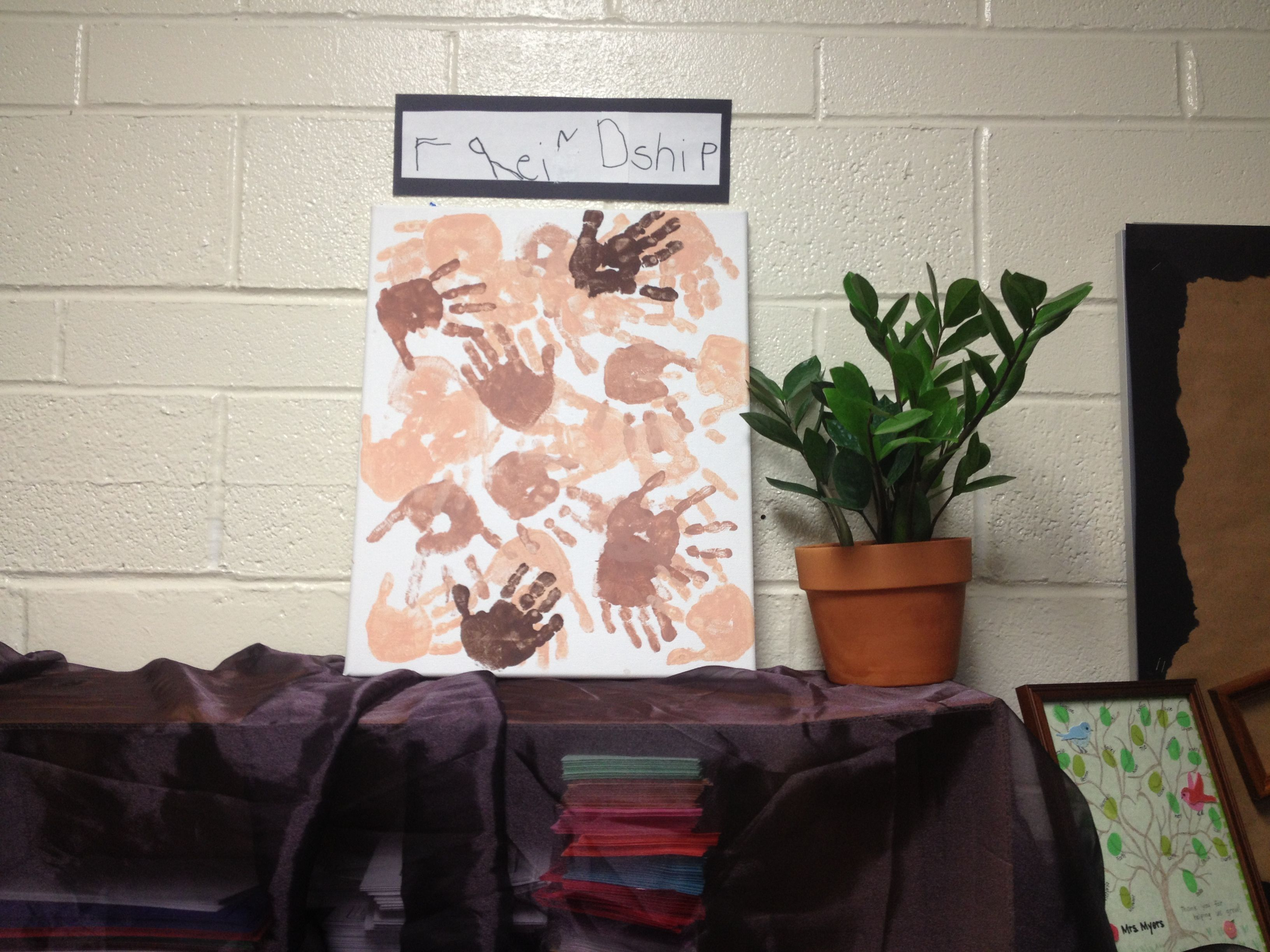 Friendship mural- the kids mixed brown and peach paint to match their skin color, then made a handprint #darlamyersclass