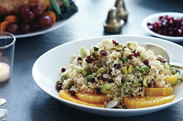Stanley Tucci's Gluten Free Quinoa Salad With Pomegranate and Pistachio | This gluten free salad recipe is the creation of his wife who adds a splash of lemon juice, pomegranate arils (seeds), pistachio nuts and green onions, creating a dish that pops with flavor! Garnish it with freshly sliced orange rings for even more festive flare during the holiday season.