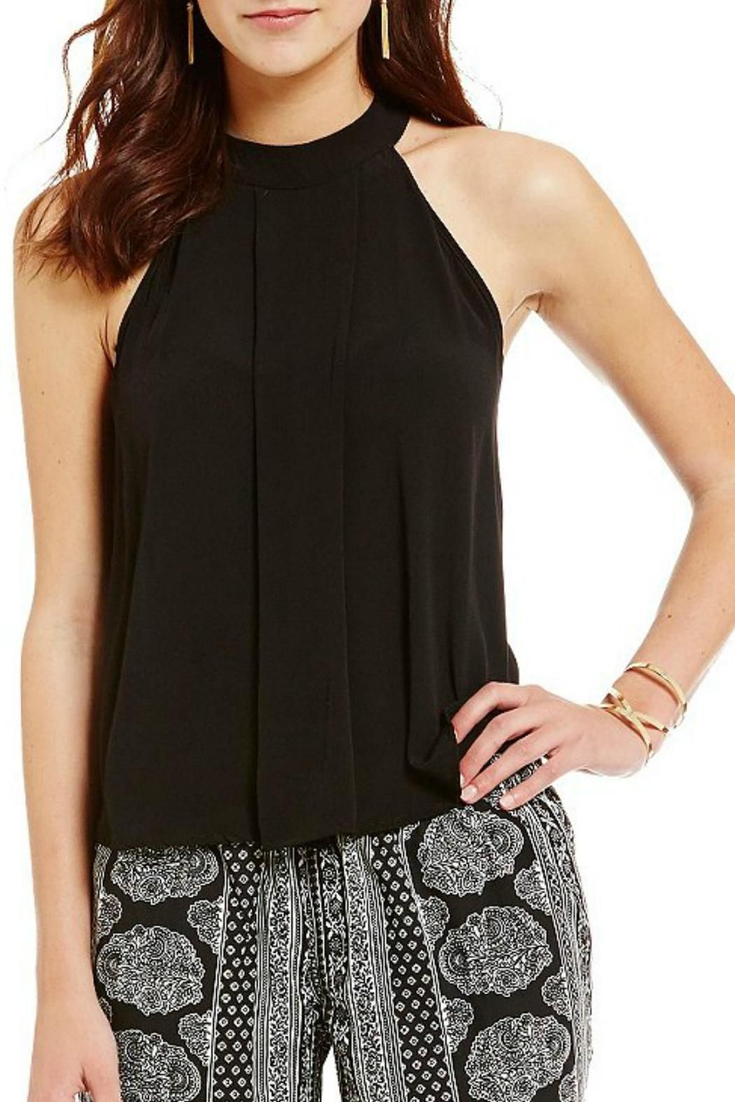 """Flowy halter top, great with jeans or under a suit jacket for work. 2 mother-of-pearl buttons at the back top of neck. The fabric is a crepe texture which could be dressed up with a skirt and accessories for a more formal look.Measures approximately 23"""" from top of shoulder to bottom hem (size medium) Halter Top by Beth Friedman. Clothing - Tops Arizona"""