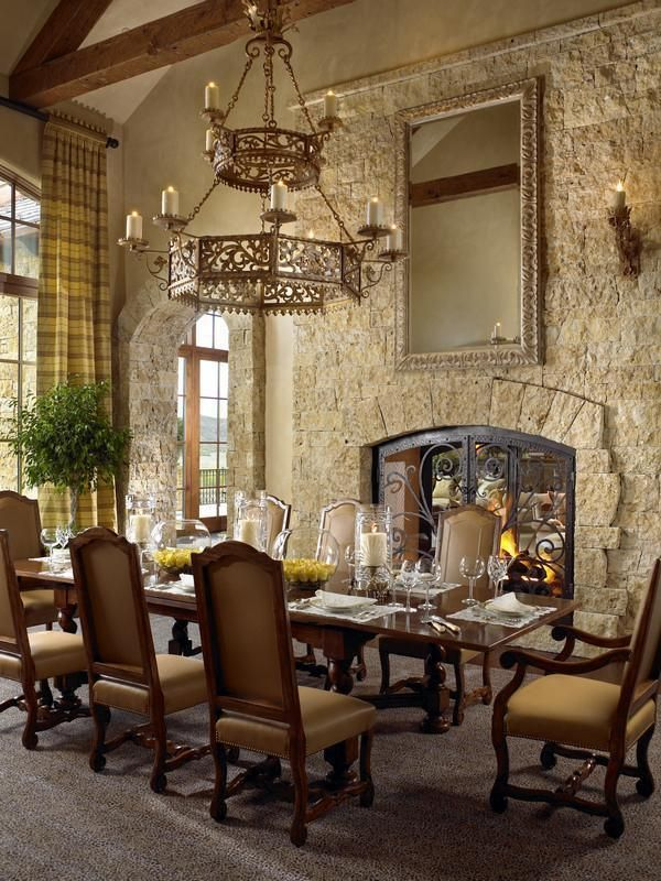 Mediterranean Formal Dining Room With See Through Fireplace To Living