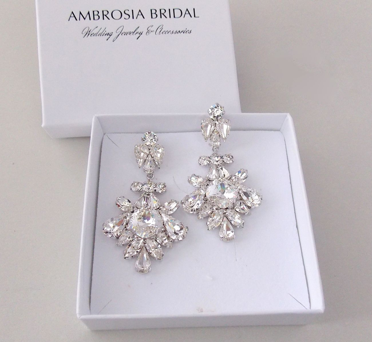 Add flare to your wedding gown with our statement earrings add flare to your wedding gown with our statement earrings arubaitofo Gallery