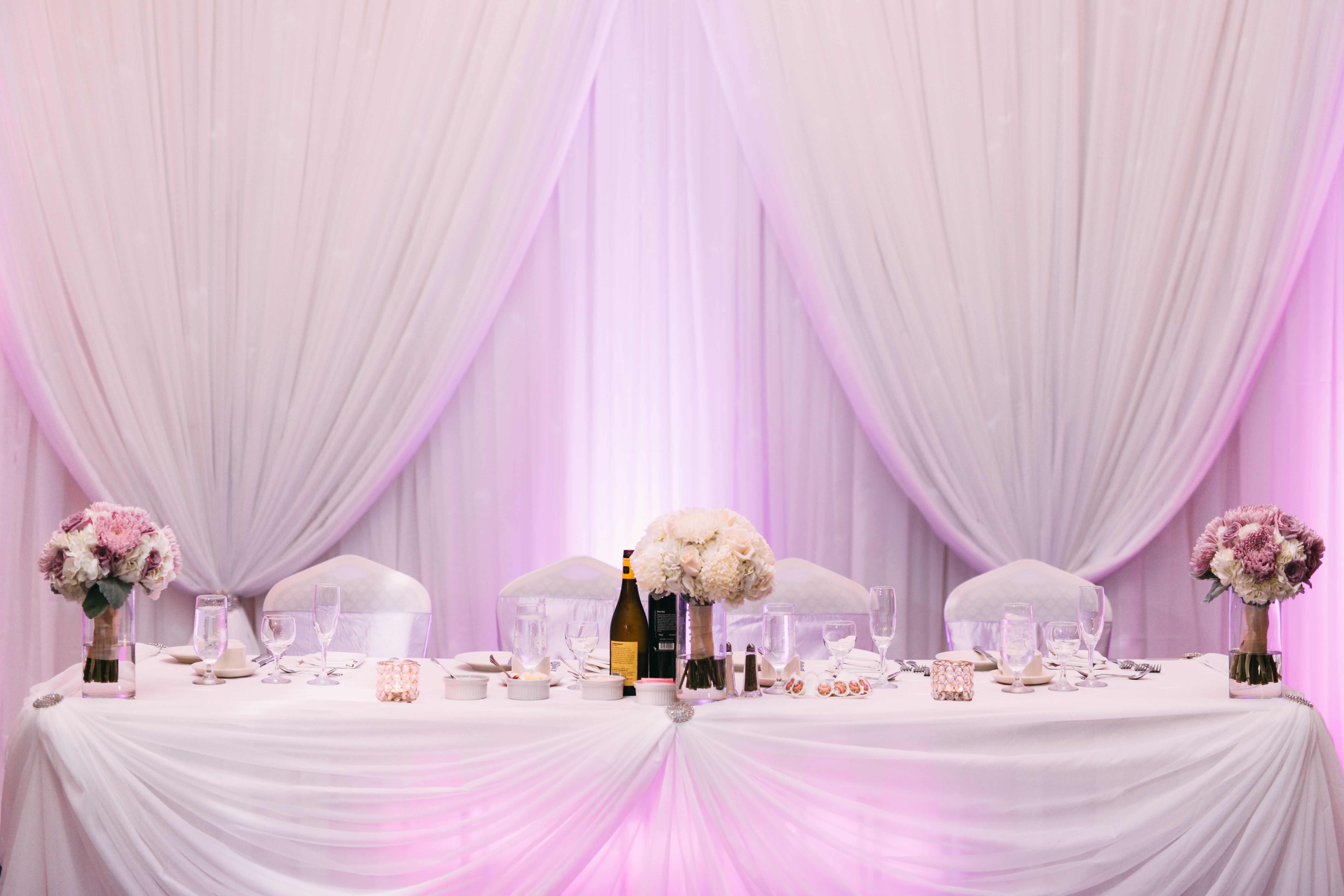 White Wedding Backdrop, purple up lighting, white head table Picture ...