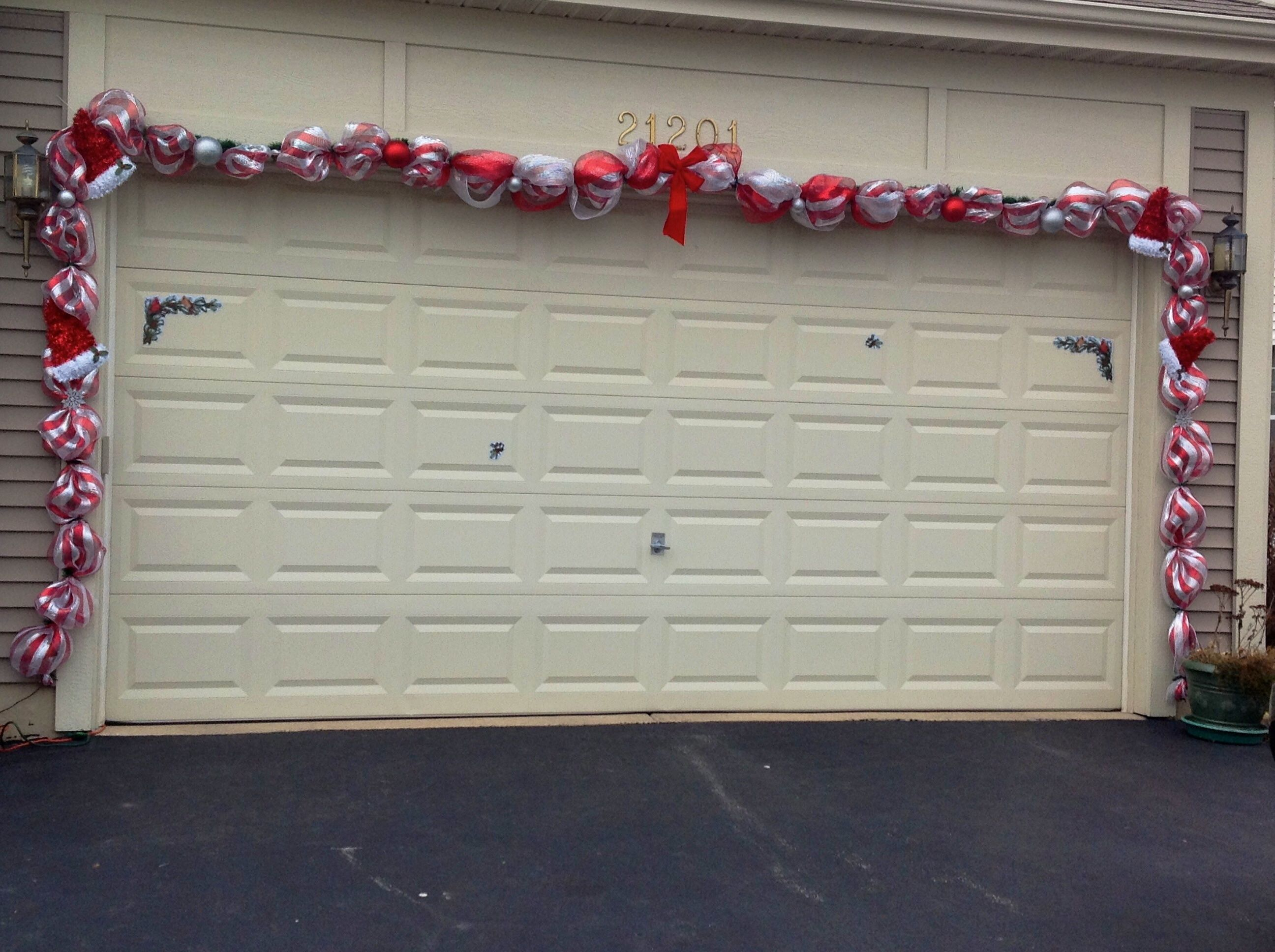Christmas Garland Over The Garage Door. It Also Has Lights On It Too.  Matches