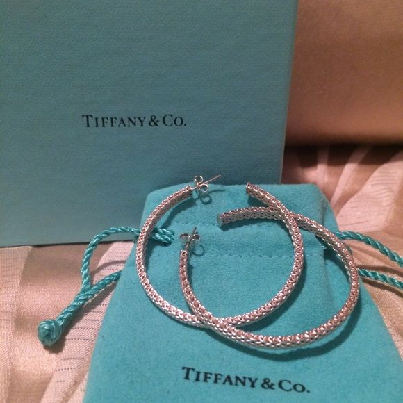 Tiffany & Co Sterling silver Somerset earring Authentic Tiffany & Co Sterling silver Somerset hoop earring. Very rare large hoop style. Tiffany blue box included with purchase. Tiffany & Co. Jewelry Earrings