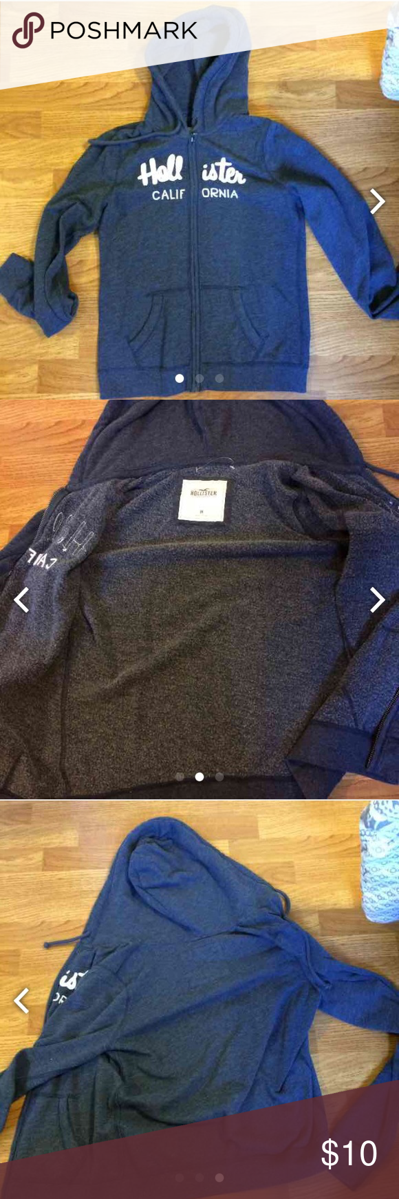Hollister navy blue jacket Navy blue fleece jacket from Hollister! Worn less than 5 times! Has white writing on the front and two pockets on the front! Has a drawstring on the hood. Cheaper on merc, same user. Hollister Tops Sweatshirts & Hoodies
