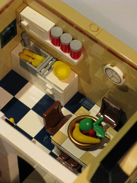 Tan Townhouse Kitchen by Kristel from Eurobricks.  Sink with drying rack, upper cabinet with spice jars.