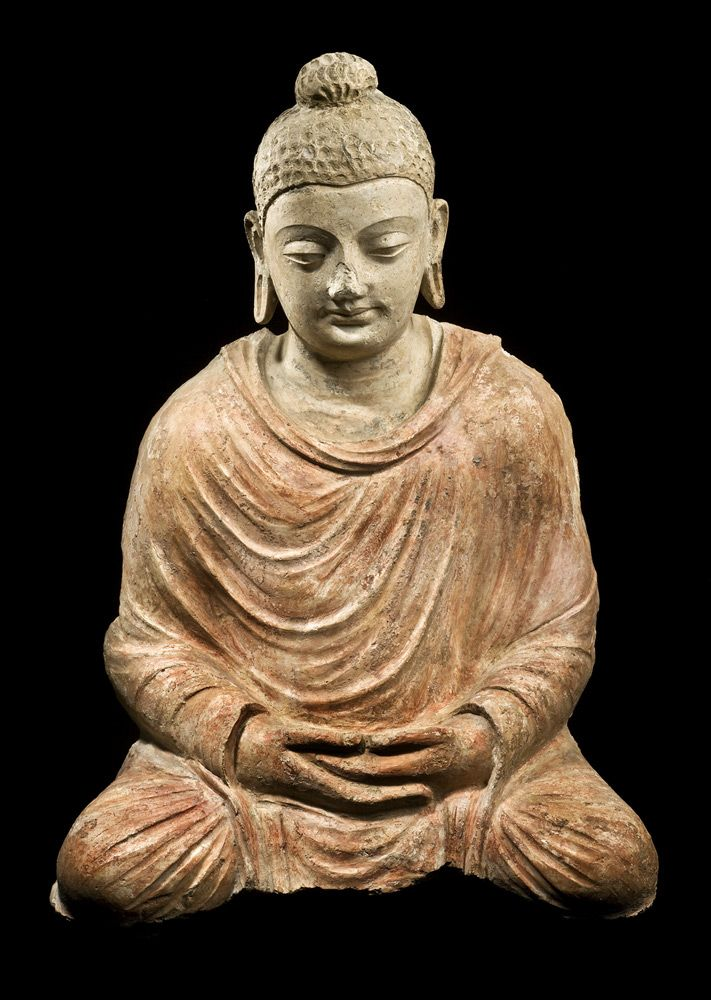 Stucco Seated Buddha Gandhara, Northwest Pakistan Hadda style 4th-5th century H. 52 cms, 20 ½ ins A large and exceptional stucco figure of Buddha, seated in dhyana (meditation)-mudra, wearing a sanghati covering both shoulders and legs, his head tilted slightly to the left, his face meditative and serene beneath a dimpled coiffure rising to a bun-shaped usnisha, with extensive traces of red pigment remaining.