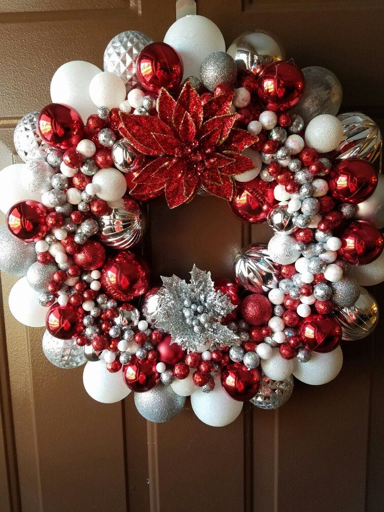 Used a Styrofoam wreath. Wrapped wreath in red burl lap to