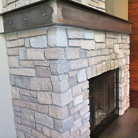 Steel Wrap Mantel Over Rock Mason Fireplace With Steel Inset