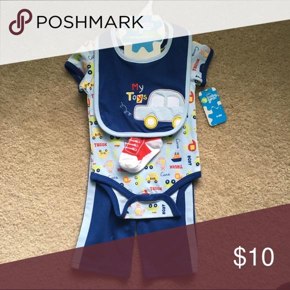 NWT 6-9 month four piece set NWT 6-9 month four piece set- onesie, pants, socks and bib. Baby Gear Matching Sets