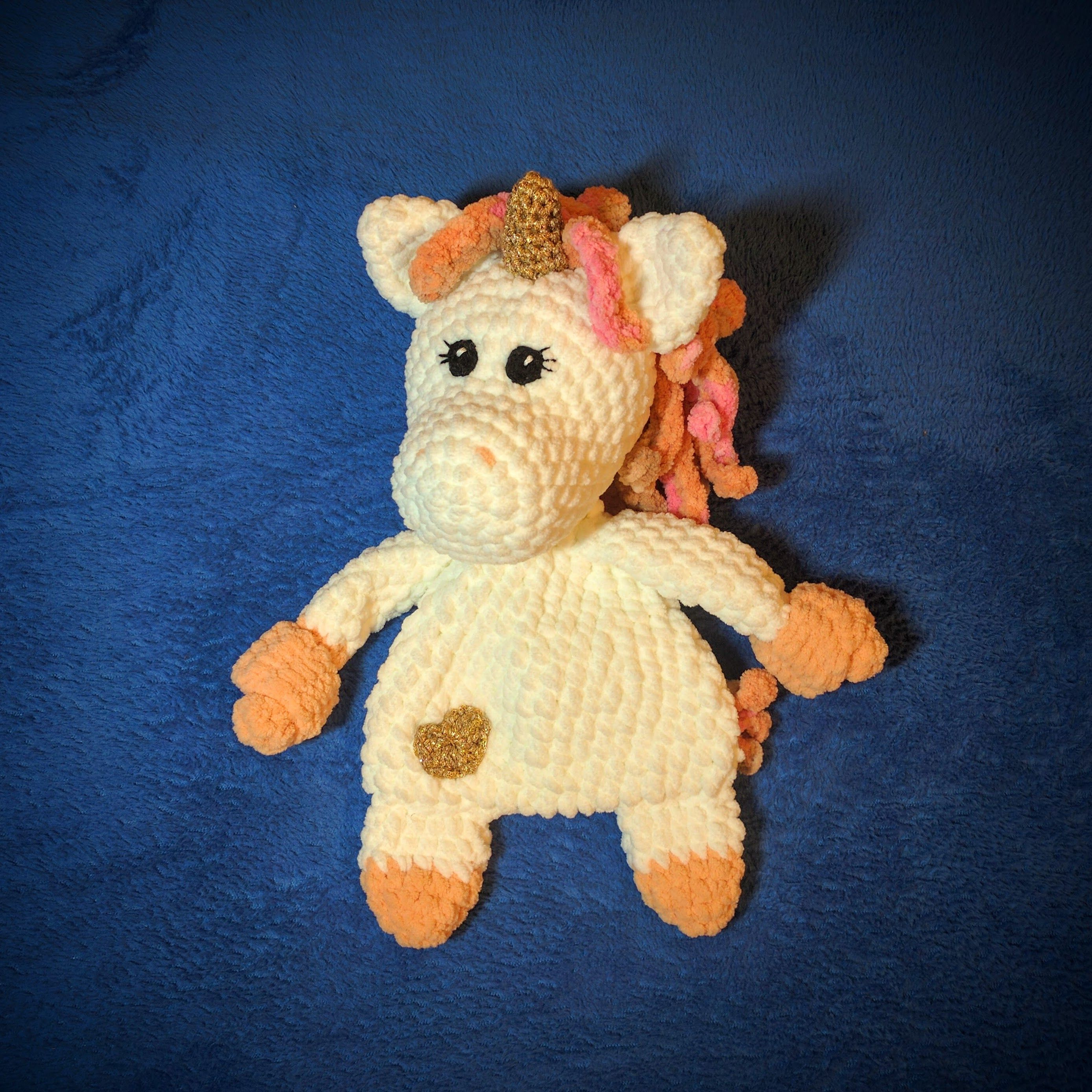 Sparkle the Unicorn Cuddler in super bulky yarn and 6.5 mm hook. A ...