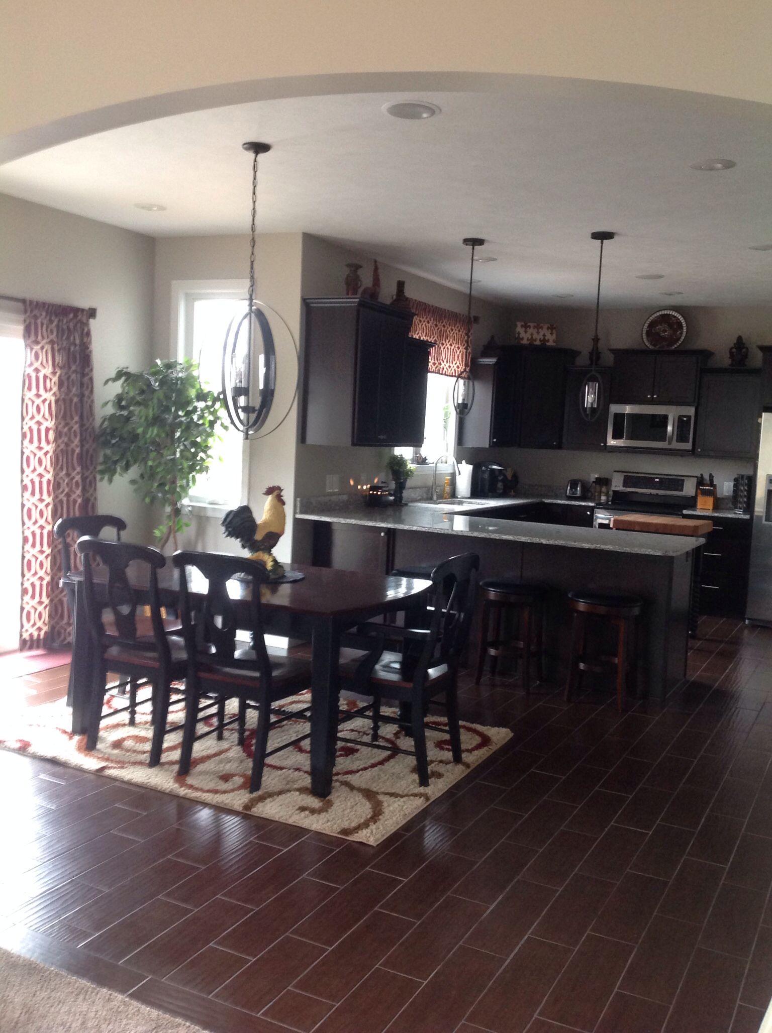 """Black cabinets, brown """"wood"""" tile.   Kitchen flooring ..."""