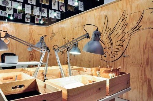 stencil technique wall decoration tattoo shop interior design ...