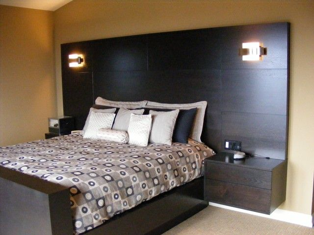 Custom TV bed  TV pops up out of the footboard  All beds are custom. Reclaimed wood headboard and bed with floating shelves  featuring
