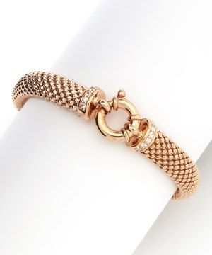 Add a little luxury into any wardrobe with a piece that effortlessly ups style. Boasting gleaming cubic zirconia accents atop a ravishing 18-karat rose gold-plated sterling silver finish, this bracelet is a must-have for shimmer-loving ladies.
