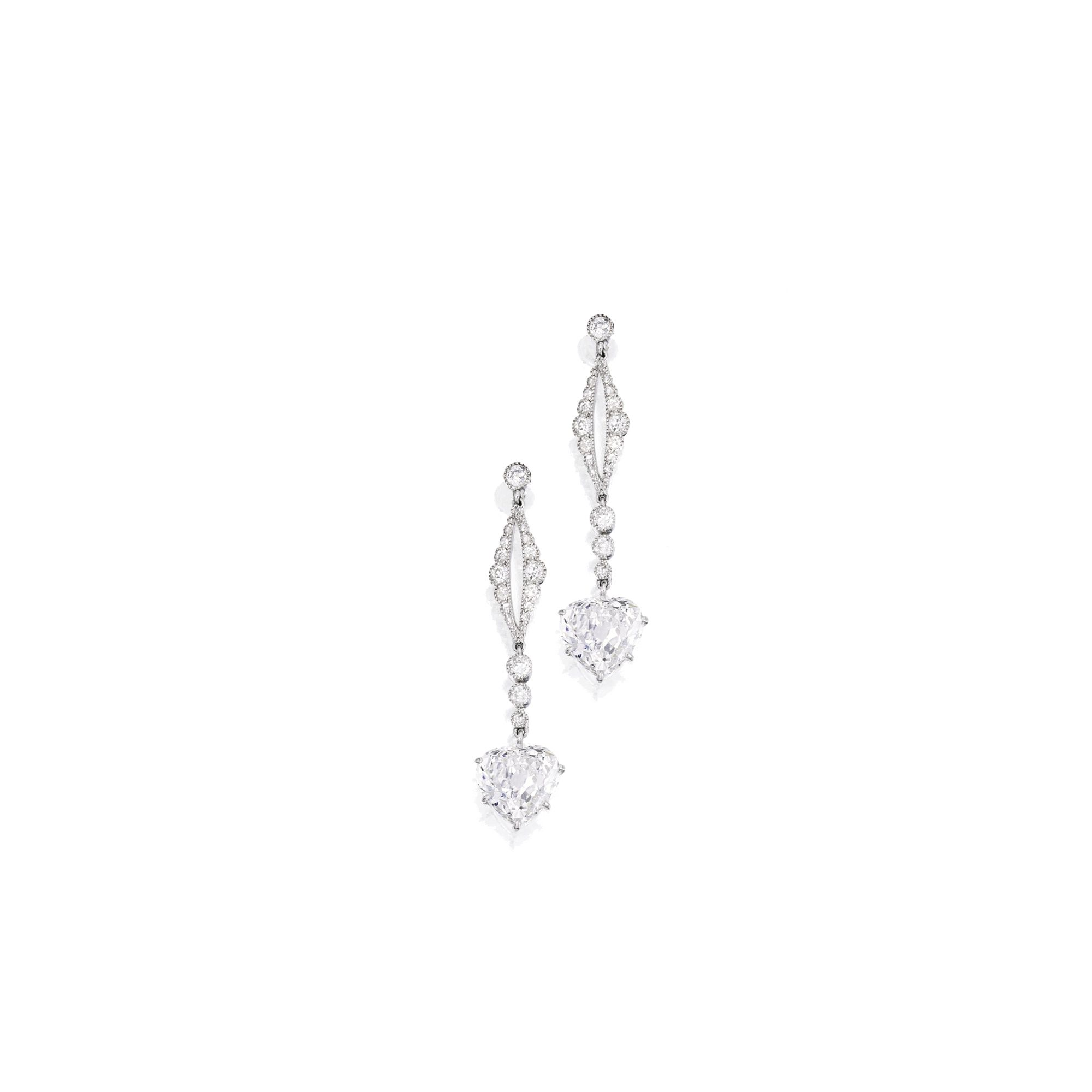 Pair of platinum and diamond pendantearrings the heartshaped