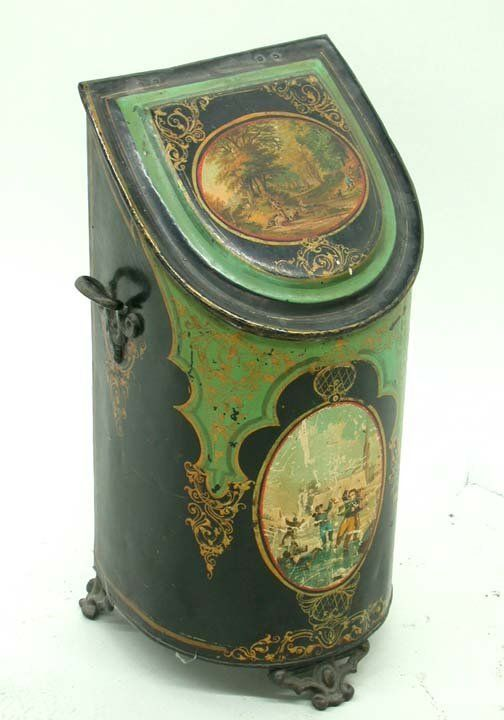 TOLE COAL SCUTTLE:   Metal, Decal + tole painted coal scuttle w/ handled insert, demilune shape hinged lid, side handles + three decorated feet, late 19th c.*VICTORIAL TOLE COAL SCUTTLE:   Metal, Decal + tole painted coal scuttle w/ handled insert, demilune shape hinged lid, side handles + three decorated feet, late 19th c.