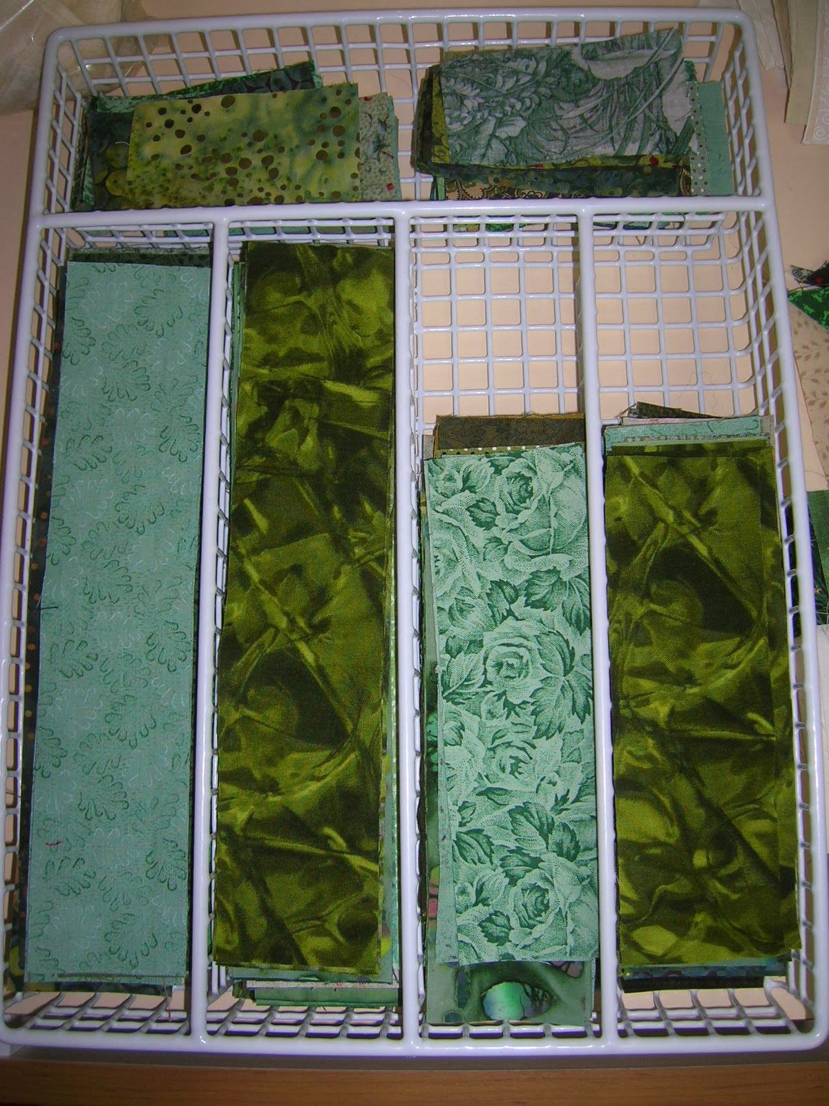 Grass Roots Quilting: The Process of Cleaning... I like the scrap storage. I need to find a silverware tray like this, where the trays will stack. All the ones I've been seeing nest together.