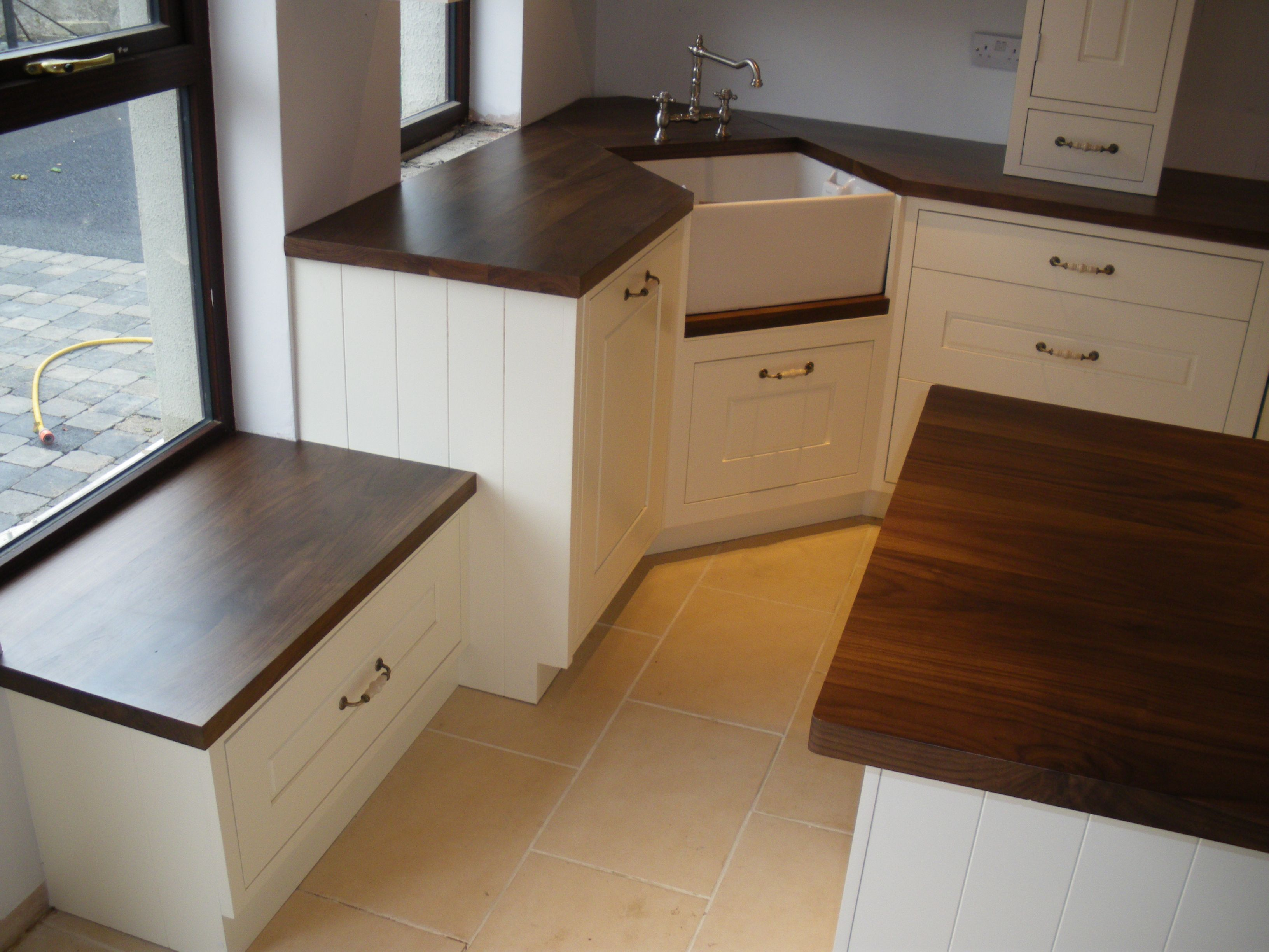 painted kitchen with walnut worktops | cream cabinets, terracotta