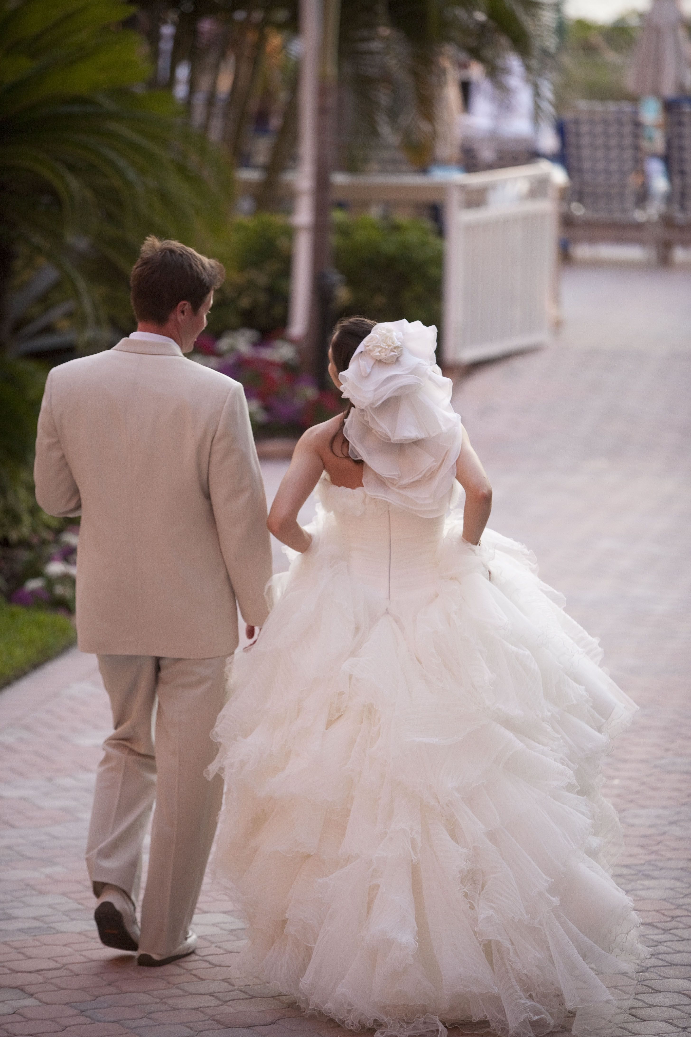 Layered bustle added to romantic theme of wedding highlights of