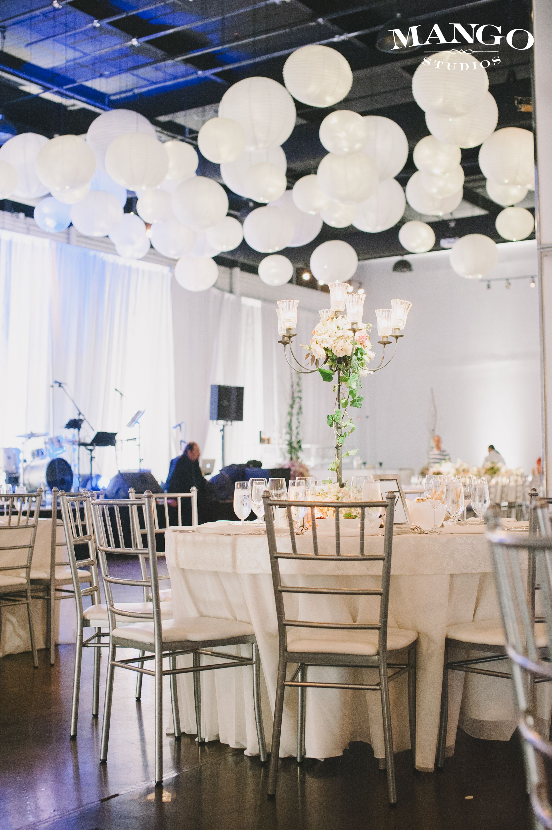 W reception at The Warehouse Event Venue White draping tables