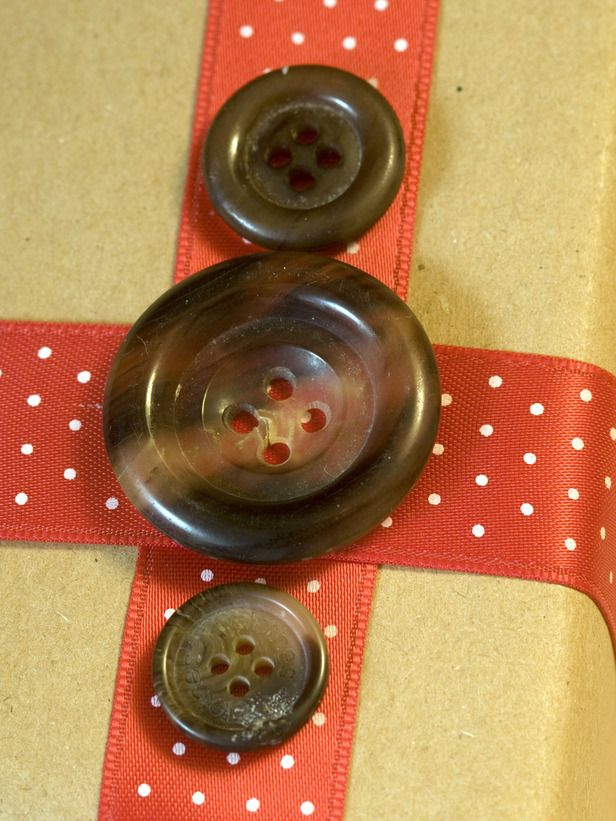 Ribbon and Buttons    Wrap recycled ribbon around the gift and glue different-sized buttons onto the ribbon.