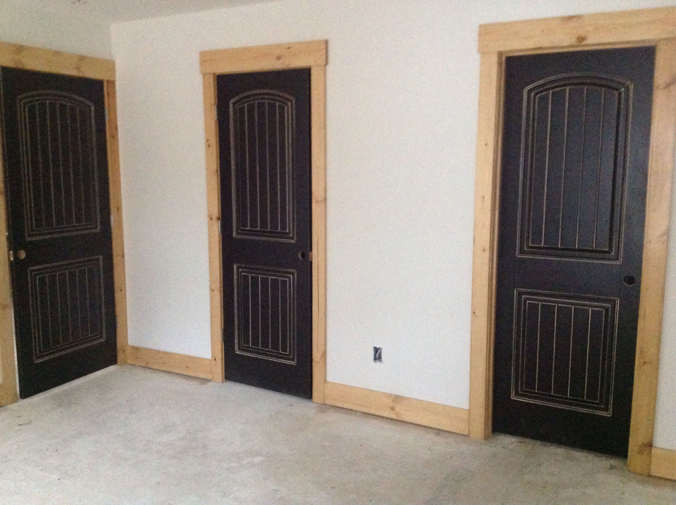 Black distressed doors with natural wood frame trim in parent 39 s lake house interior barn for Distressed wood interior doors