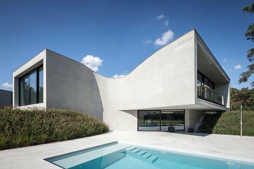 Office O Architects Sculpts Villa Mq From Curved Concrete Concrete Architecture Architecture Architect