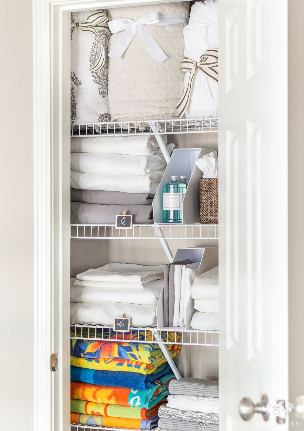 A Small Organized Linen Closet And Ideas To Store Bulky Bedding Kelley Nan Organizing Linens Linen Closet Organization Linen Closet