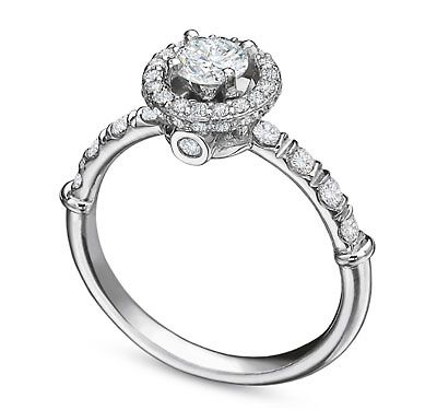 Its that perfect combination of classic meets contemprary.   http://www.kooroshandvalencia.com/vintage-pave-set-halo-diamond-engagement-ring.aspx
