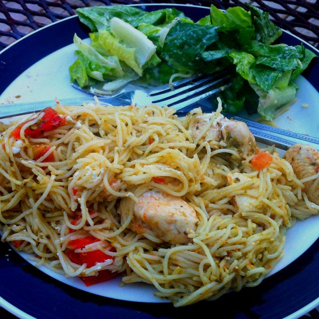 Chicken, tomato, red pepper, over angel hair pasta with pesto sauce! Tonight's creation.