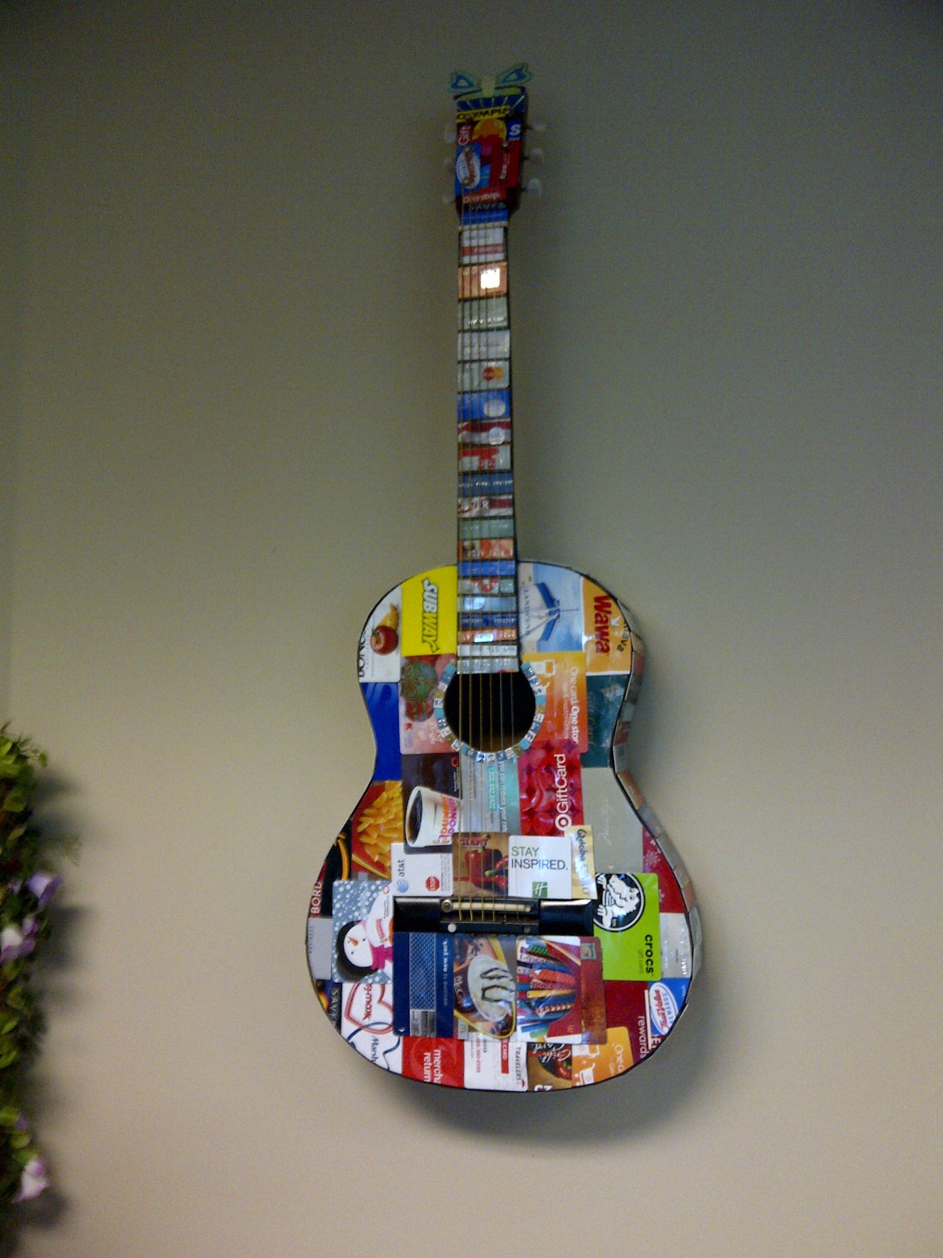 3 4 size guitar decorated with used credit and gift cards