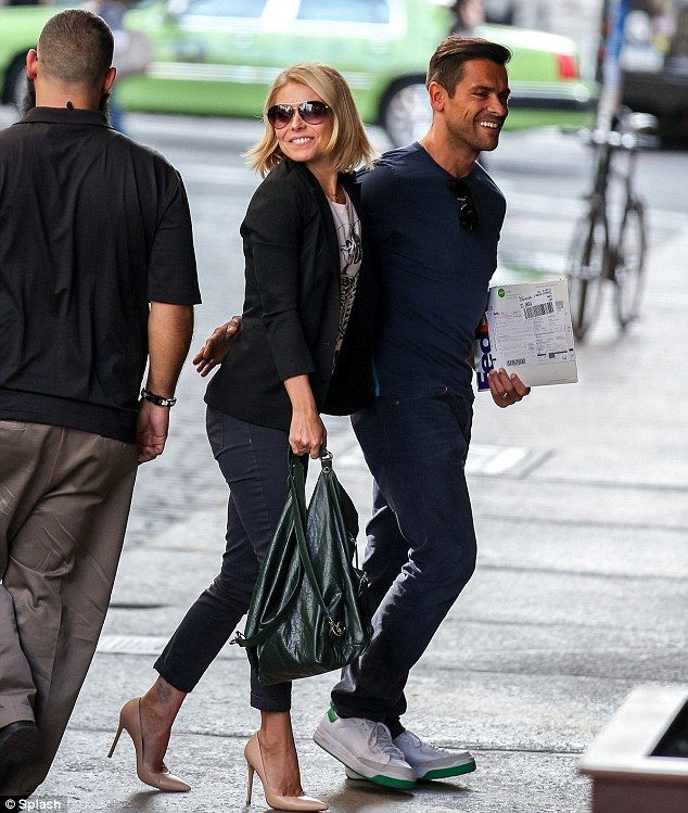 Kelly Ripa And Mark Consuelos Can't Keep Their Hands Off