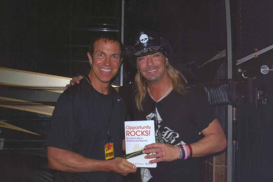 Me giving a copy of my book to Bret Michaels!