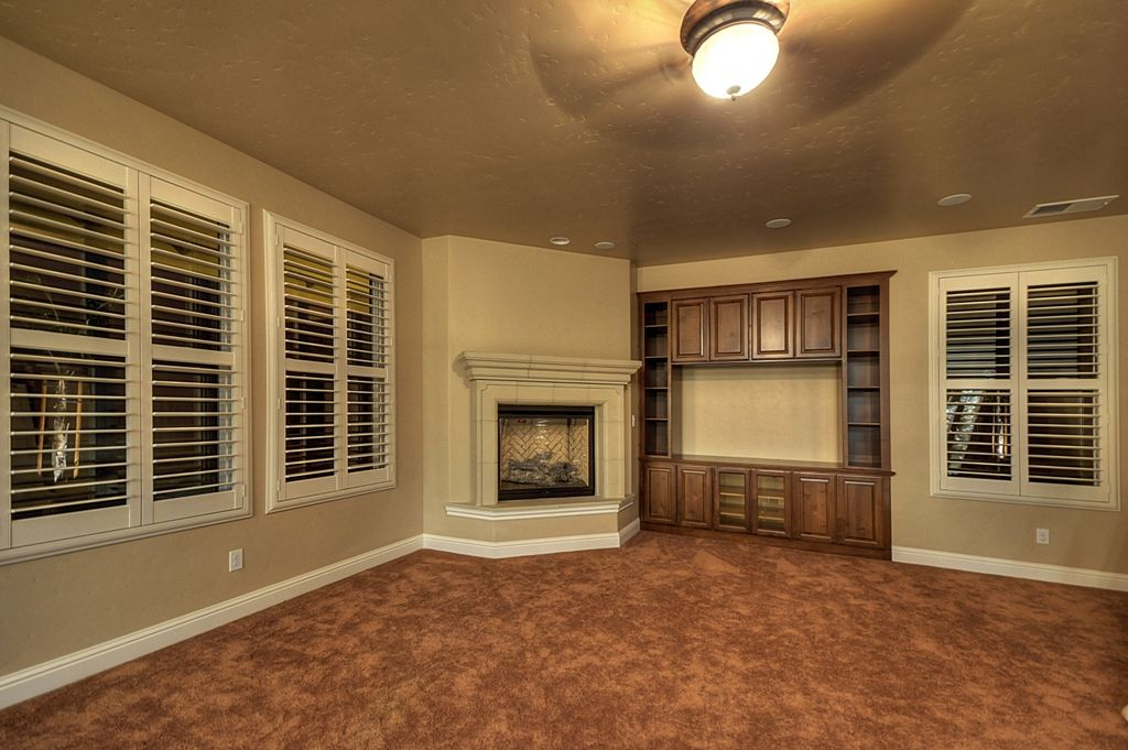 Fireplace Design east bay fireplace : Living room with fireplace and built in shelves in a suburban ...