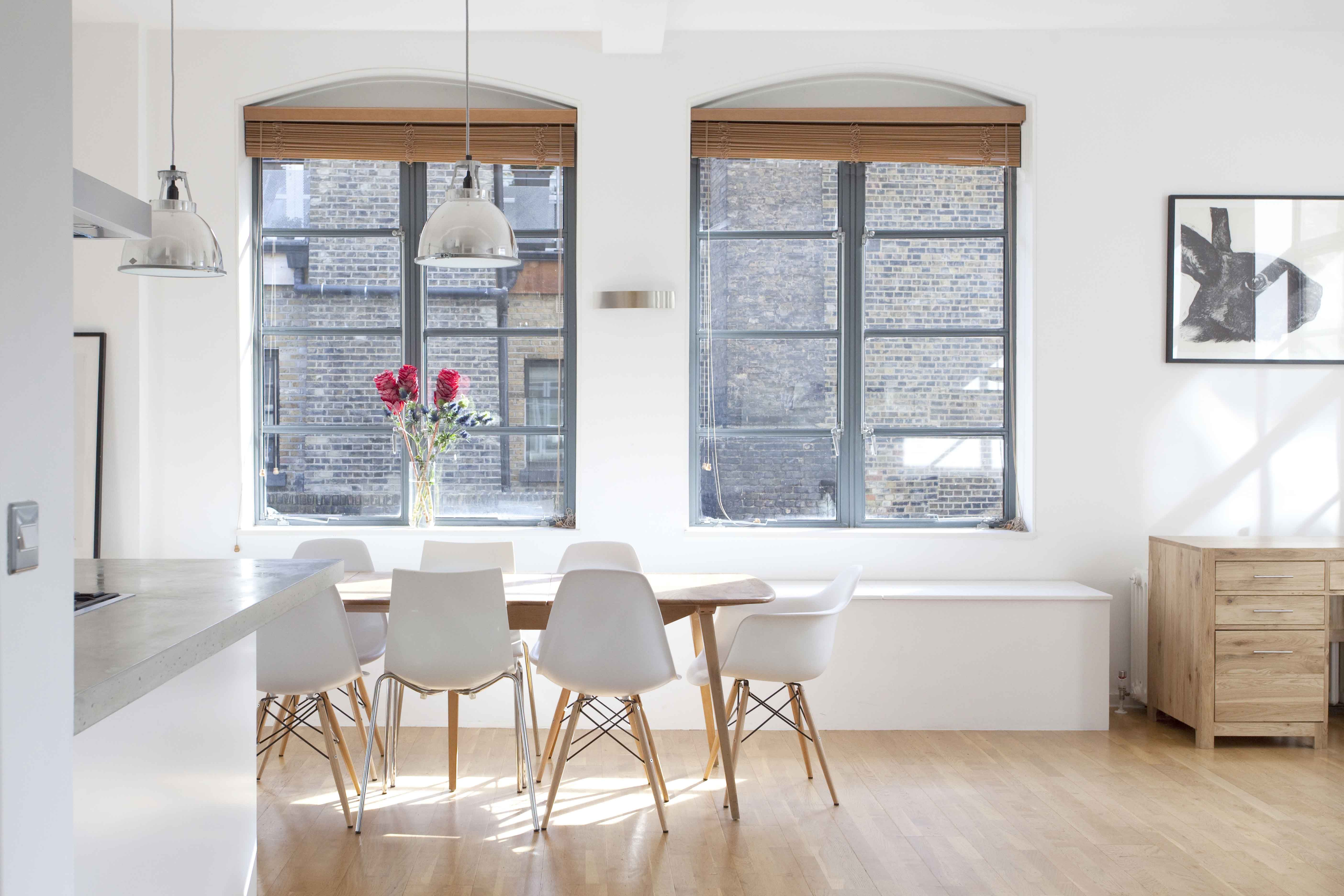 Dining area, wooden dining table, white chairs, two arched windows ...