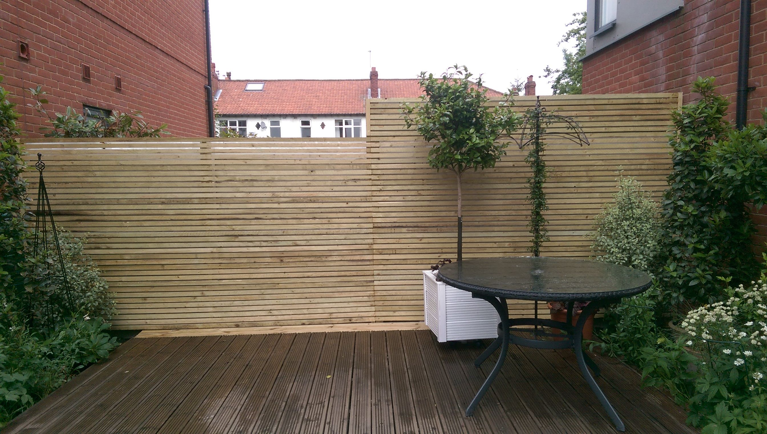 This image shows a pressure treated slatted screen fence panel this image shows a pressure treated slatted screen fence panel improve the aesthetic of a garden baanklon Choice Image