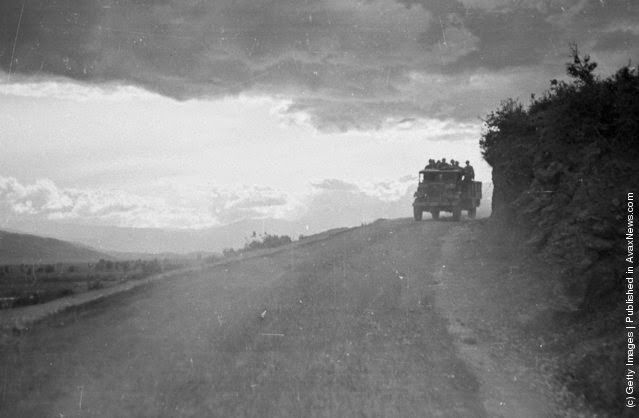 During the Greek Civil War, government troops are instructed to cease travelling and fortify their position during the night, when the guerrilla army is more likely to attack. The last transport of the night makes its way along a lonely mountain road. (Photo by Bert Hardy/Picture Post/Getty Images). 22nd May 1948