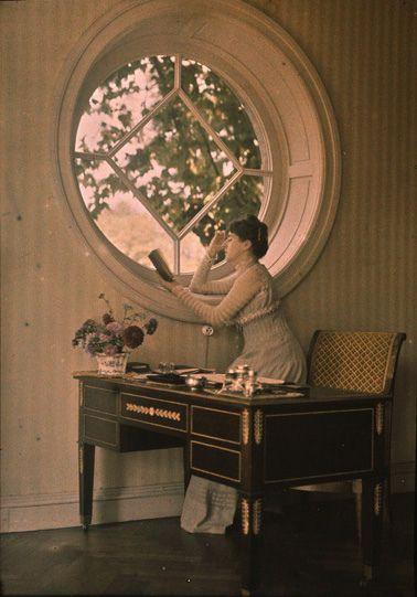 Autochrome: Antonin Personnaz. Woman leaning out window. c. 1910.