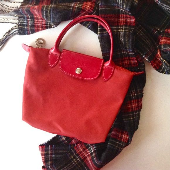 1a5cbb13bcf  Longchamp  Mini Red Neo Le Pliage Bag This is an 💯% authentic Longchamp  le Pliage mini red handbag. See second pic for size reference!