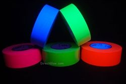 http://www.directglow.com/2_Inch_Blacklight_Reactive_Fluorescent_Gaffer_Tape_p/bltape2v50.htm  2 Inch Blacklight Reactive Fluorescent Gaffer Tape glows under UV light! Gaffer tape is a high quality vinyl-impregnated cloth with a non-reflective matte finish and excellent adhesion.  Clean removal, abrasion and water resistance. Gaffer tape is more supple and conformable than duct tape and is used by film crews for shoots, stage sets, and at conventions for securing wires, cables and props.