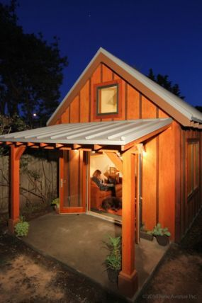 Small house - small home in Berkeley CA.   Redwood siding over rough sawn plywood, metal roof.