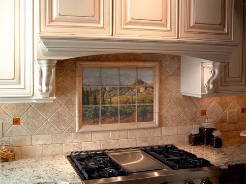 marble tuscan tile mural backsplash. pretty but almost too much